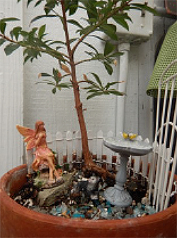 Ceramic Fairy with small tree and fountain